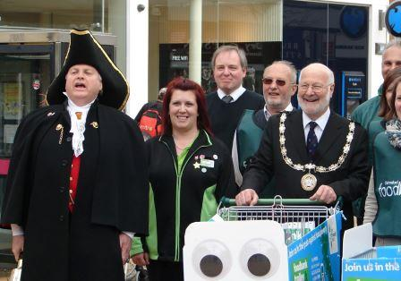 The Mayor pushed the food trolley around the town sign in support of Chelmsford Foodbank